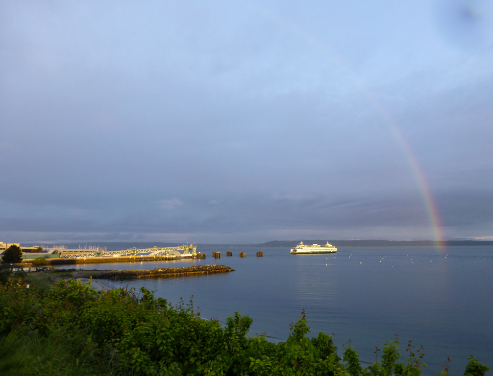 Rainbow over Ferry approaching the Edmonds, WA, terminal