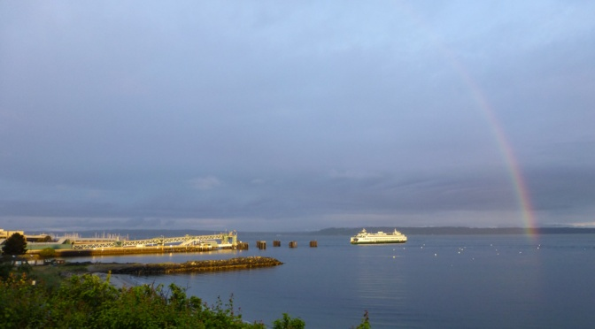 Rainbow over Ferry approaching the Edmonds, WA, terminal
